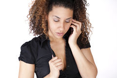Sensual Mobile conversation. A woman with a sensual expression talking on a mobile device Stock Image