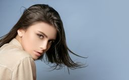 Sensual model girl with smooth skin and makeup. Cheerful happy young beautiful girl. Female fasion. Portrait of serious