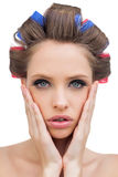 Sensual model with hair curlers Royalty Free Stock Images