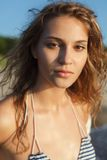 Sensual model portrait. Sensual model is posing near sea. Sunset, outdoor shoot Royalty Free Stock Images