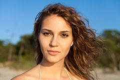 Sensual model portrait. Sensual model is posing near sea. Sunset, outdoor shoot Stock Photos