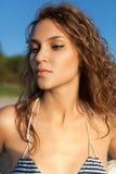 Sensual model portrait. Sensual model is posing near sea. Sunset, outdoor shoot Stock Photography