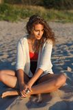 Sensual model portrait. Sensual model is seating. Sunset, outdoor shoot Stock Photography