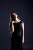 Sensual model posing in elegant cocktail dress Royalty Free Stock Photography