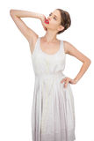 Sensual model in white dress posing looking away Royalty Free Stock Photography