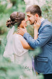 Sensual moment of romantic newly married couple in green summer park Stock Image