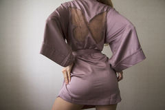 Sensual motion of woman in pink robe 2 Royalty Free Stock Photos