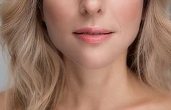 Sensual mouth of attractive elegant lady royalty free stock photography
