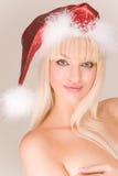 Sensual mrs. Santa. Sensual topless mrs. Santa in red hat stock photos