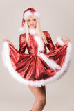 Sensual mrs. Santa in red dress. And hat royalty free stock image