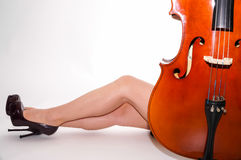 Sensual musical prelude. High hells, sexy legs and cello Royalty Free Stock Photo