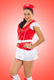 Sensual nurse on red stock photography