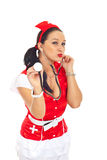 Sensual nurse sending kisses Royalty Free Stock Images