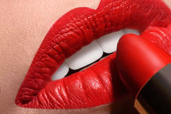 Sensual open mouth  with red tube of lipstick Royalty Free Stock Photography
