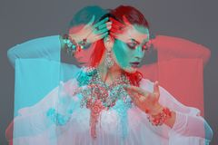 Sensual belly daner dancing portrait red cyan double exposure Stock Photo