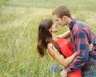 Sensual outdoor portrait of young attractive couple in love kiss. Stunning sensual outdoor portrait of young stylish fashion attractive couple in love kissing in stock photography