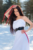 Sensual young beautiful brunette girl in snowy forest Stock Image
