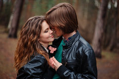 Sensual outdoor portrait of young loving couple kissing Stock Image