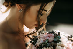 Sensual photo of the bride with a bouquet. A Stock Image