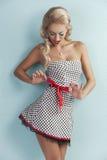 Sensual pin girl up playing with ribbon Royalty Free Stock Photos