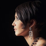 Sensual portrait of a beautiful lady with diamond earring Royalty Free Stock Photo