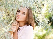 Sensual portrait of a beautiful young woman in garden Royalty Free Stock Image