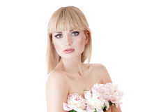Sensual portrait of a blond woman with flowers Royalty Free Stock Photo