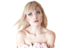 Sensual portrait of a blond woman with flowers. Stock Images