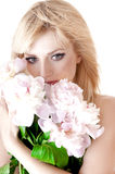 Sensual portrait of a blond woman with flowers . Stock Photos