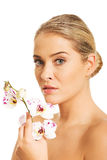 Sensual portrait of nude woman with orchid flower Royalty Free Stock Photo