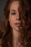 Sensual portrait of a redheaded beautiful woman.  Stock Image