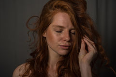 Sensual portrait of a redheaded beautiful woman.  Stock Photography