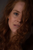 Sensual portrait of a redheaded beautiful woman Royalty Free Stock Images