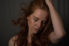 Sensual portrait of a redheaded beautiful woman.  royalty free stock photo