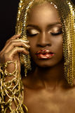 Sensual portrait of sexy african american female model with glossy makeup and golden paillettes wig. Fashion Vogue Royalty Free Stock Photos
