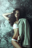 Sensual portrait of sexy young woman with dark curly hair Stock Photos