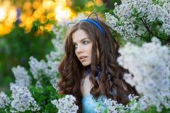 Sensual portrait of spring woman, beautiful face female enjoying cherry blossom Stock Photo