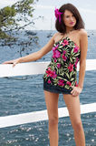 Sensual pretty girl with mini skirt. Sexy ans d beautiful young woman wearing a mini skirt and posing near the sea Royalty Free Stock Images