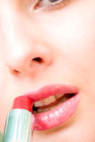Sensual pretty woman applying cosmetics Stock Image