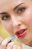 Sensual pretty woman applying cosmetics Stock Photo