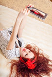 Sensual  pretty young redhead lady making selfie Stock Images