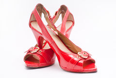 Sensual red high heels. Pair of sensual red shoes with high heels Royalty Free Stock Photo
