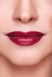 Sensual red lips macro shot. Beautiful sensual red lips macro shooting. Professional make up. Red lipstick. Toned and clean skin Royalty Free Stock Photography