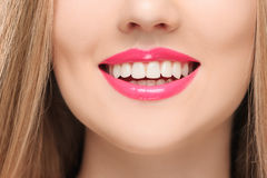 The sensual red lips, mouth open, white teeth. Stock Photos
