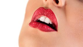 Sensual red lips of a woman. Sensual red woman lips.Half open red lips Stock Photography