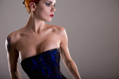 Sensual redhead woman in blue corset Royalty Free Stock Photo