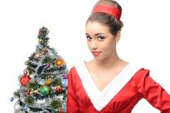 Sensual retro girl near christmas tree Stock Photos