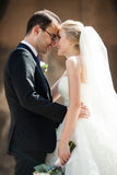 Sensual romantic couple of newlyweds hugging in front of old chu. Rch closeup Royalty Free Stock Photography