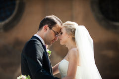Sensual romantic couple of newlyweds hugging in front of old chu. Rch closeup Stock Image