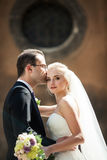 Sensual romantic couple of newlyweds hugging in front of old chu. Rch closeup Stock Photography
